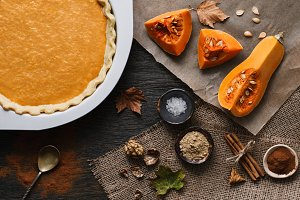 Traditional pumpkin pie and ingredients