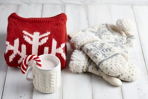Knitted cup and winter clothes