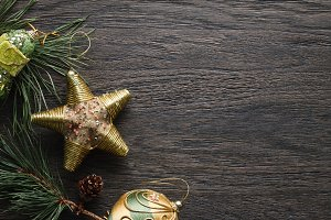 Dark Christmas background with golden decorations