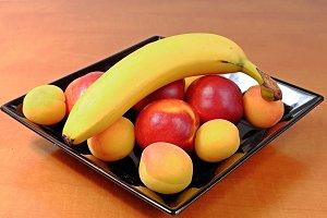 Fruit on a black plate