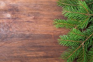 Christmas tree on old wooden board