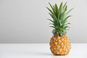 Ripe pineapple on a white table