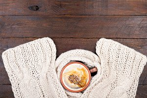 Coffee cup and knitted scarf