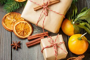 Christmas decoration with gift box and mandarines