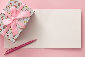 Greeting card, gift box and pen in pink colors