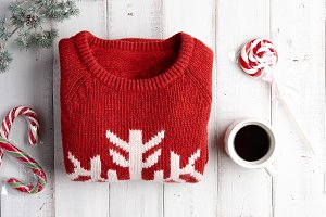 Winter background with sweater and lollipops