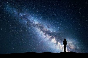 Milky Way with silhouette of a woman