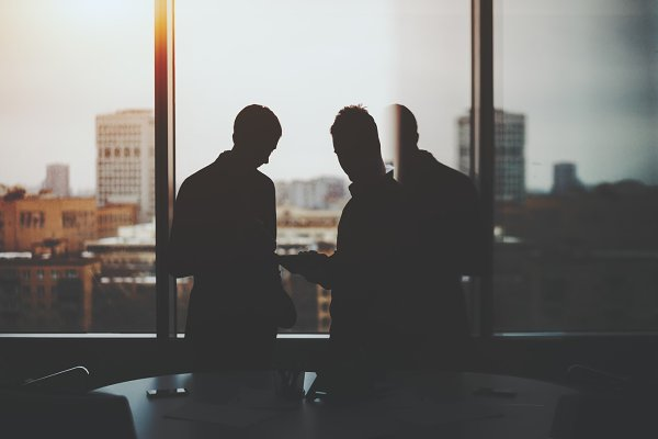 Silhouettes of two businessman