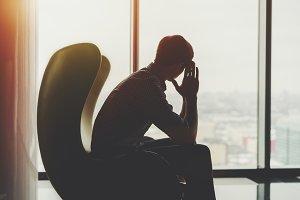 Silhouette of anxious businessman