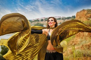 Girl dancing with golden wings.