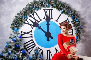 Girl. Big clock and Christmas tree