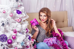 Girl, gifts and Christmas tree