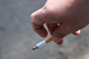 Cigarette in a fingers