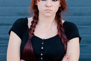 Rebel teenager girl dressed in black