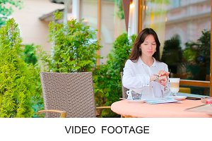 Young woman drink tea cafe outdoors