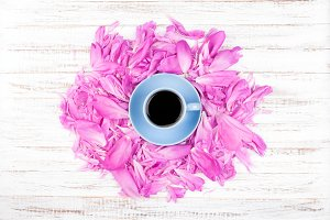 Cup of coffee and petals