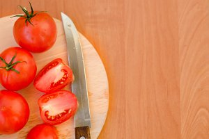 Fresh tomato on table with knife