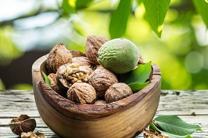 Walnuts in the wooden bowl