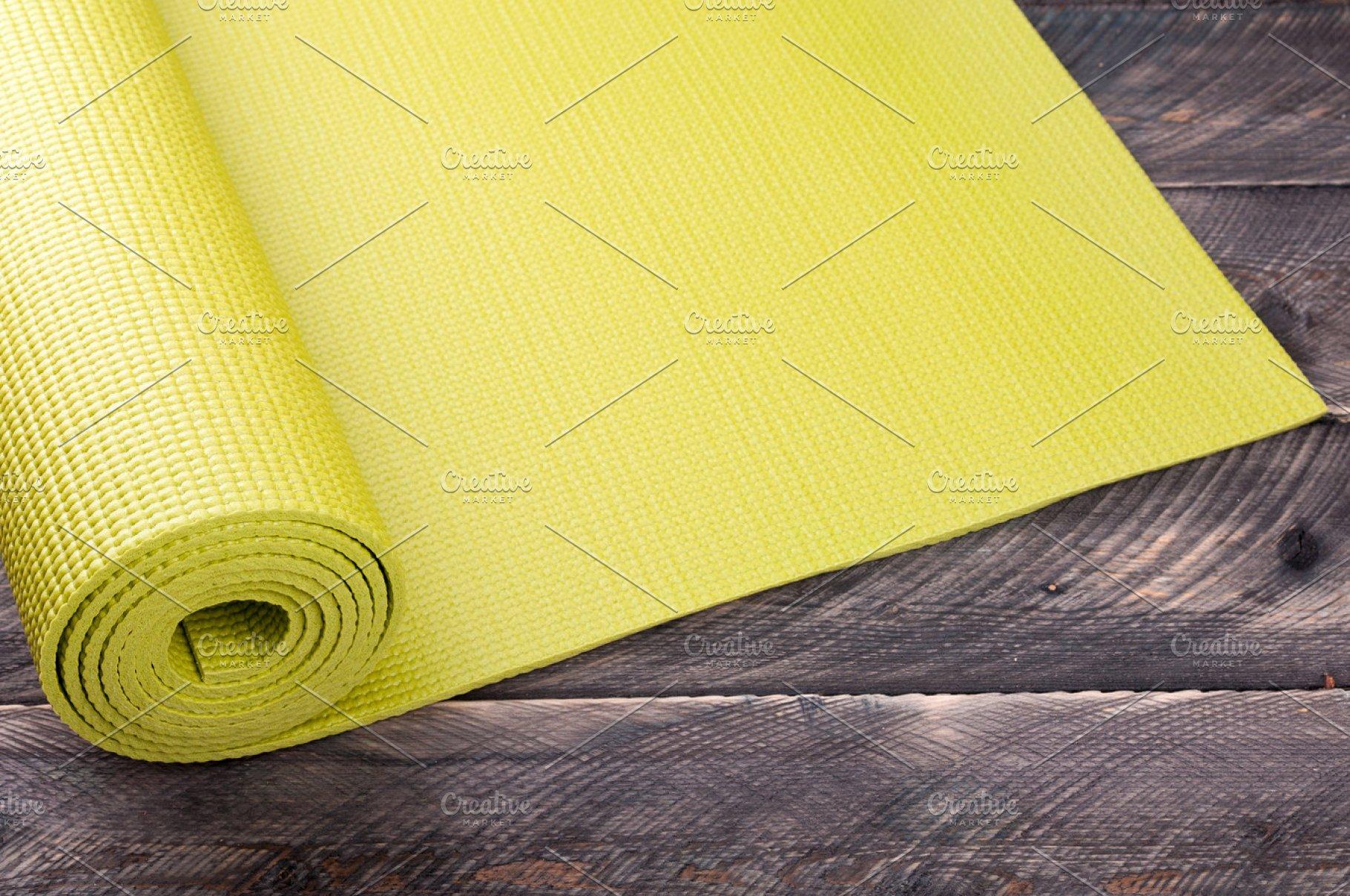 517b18c019198 Yoga mat on a wooden background ~ Sports Photos ~ Creative Market