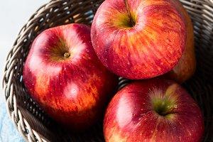 Fresh apples in basket. Top view. Closeup vertical