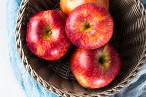 Fresh apples in basket on napkins. Healthy eating. Vertical