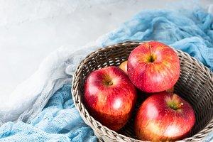 Fresh apples in basket on winter color napkins