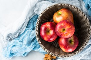 Fresh apples in basket on napkins. Healthy eating. Top view