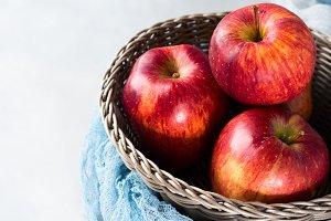 Fresh red apples in basket. Healthy eating