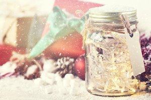 Christmas concept with lights in jar