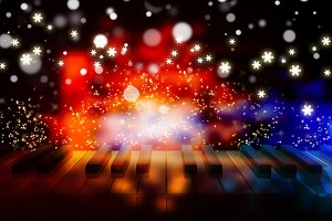 piano keys on bokeh colorful light