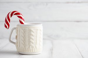 Knitted winter cup with candy cane