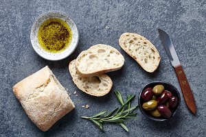 Ciabatta bread with olives, oil and herbs