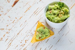 Guacamole sauce and nachos
