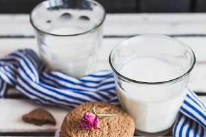 Rustic home made cookies on the wooden background with milk