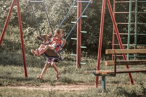 Children ride on the swing