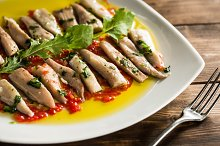 Fish slices in sauce