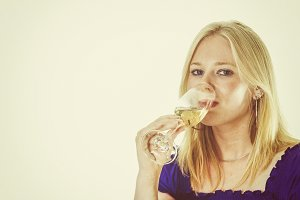 Blonde woman enjoying wine