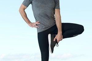 runner stretches leg