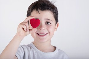 Child with a red heart