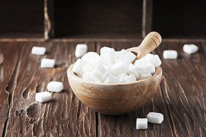 White sugar on the wooden table