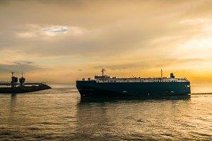 Ship cruising into harbour