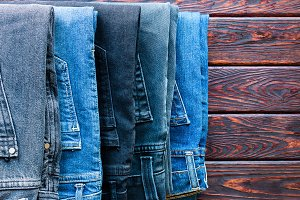 stack of different jeans