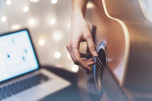 Hipster girl playing guitar