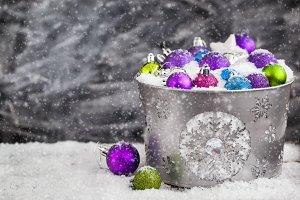 Christmas balls in a bucket