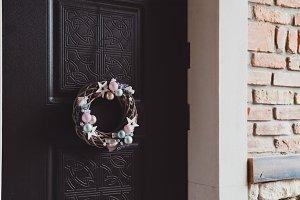 Stylish Christmas wreath on door
