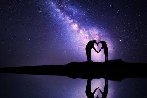 Milky Way. Silhouette of a couple