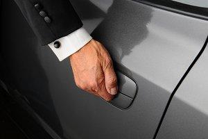 Man in Tuxedo Opening Car Door