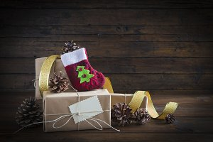 Christmas gifts on a wooden background