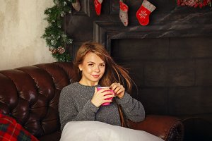 Girl drinking hot Christmas drink