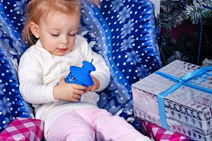 Cute little girl and Christmas gifts
